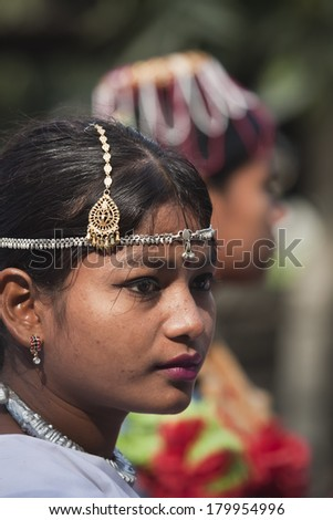 CHITWAN, NEPAL - DEC 26, 2013: Portrait of unidentified teen woman wearing tradtional clothe and jewelry for a Cultural program during elephant festival, Chitwan 2013, Nepal