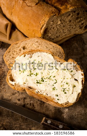 Chive and cheese cream on the slice of bread  - stock photo