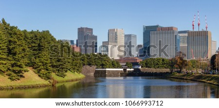 CHIYODA-KU, TOKYO, JAPAN - NOVEMBER 23rd 2018. Office buildings in the Marunouchi district of Tokyo as seen from across the Imperial Palace moat.