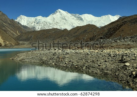 Cho-Oyu and mountain lake - stock photo