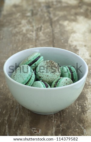 Choc mint macaroons in a bowl - stock photo