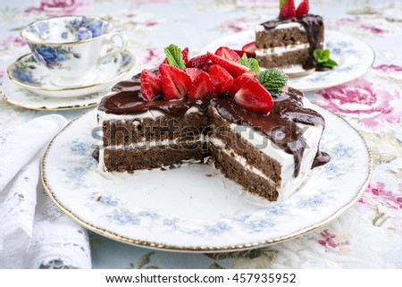 Choco Nuts Cake with Strawberries on Plate