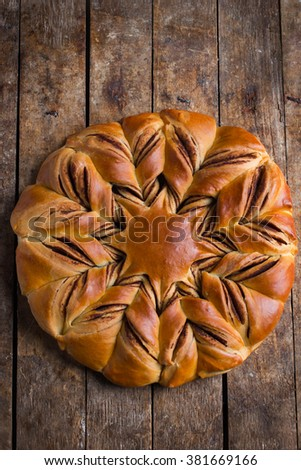 chocolate and cinnamon star braided bread, top view