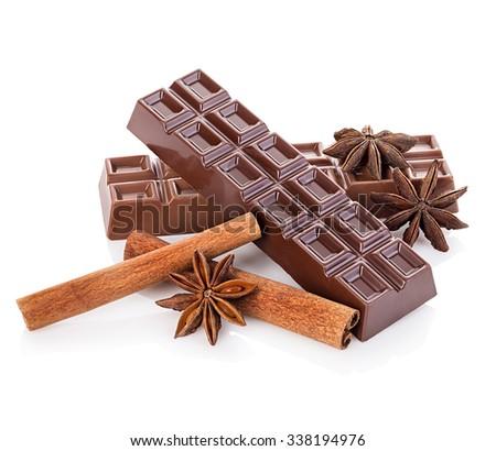 Chocolate and cinnamon sticks, star anise isolated - stock photo