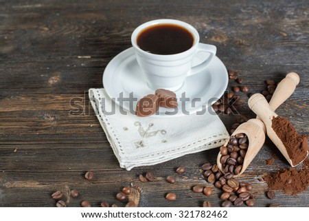Chocolate and coffee beans on a wooden background. Selective Focus