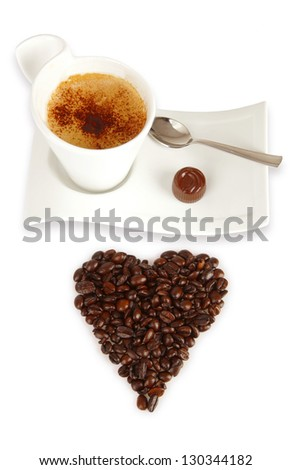 Chocolate and coffee beans on white background - stock photo