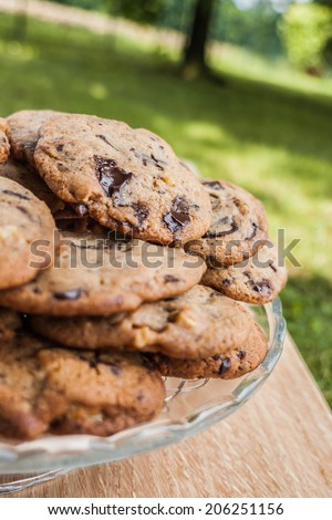 Chocolate and nuts cookies on wood bench