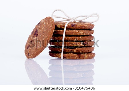Chocolate and oat cookies over white background