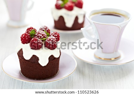 Chocolate and raspberry cupcakes - stock photo