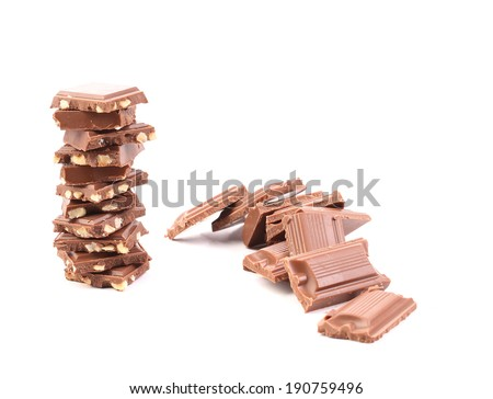Chocolate and stack with nuts. Isolated on a white background.