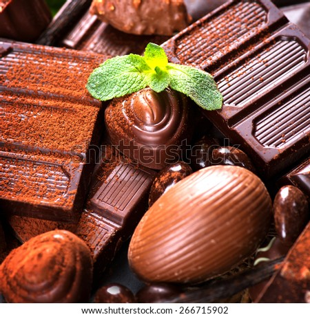 Chocolate background. Chocolate. Assortment of fine chocolates in dark and milk chocolate with mint. Praline Chocolate sweets - stock photo