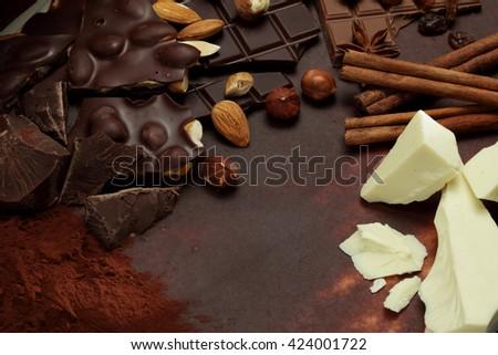 Chocolate background/ nut chocolate/ chocolate bar/ chocolate truffle/ hazelnut - stock photo