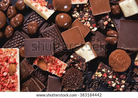 chocolate background  with candy, nuts and chocolate bar