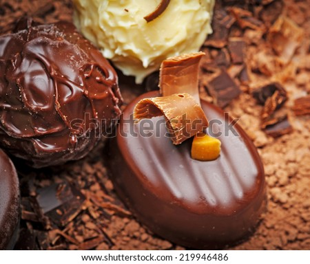 chocolate background with pralines in detail - stock photo