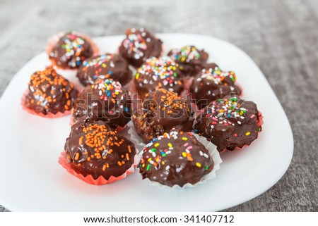 Chocolate ball with topping - stock photo