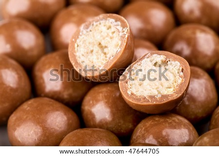 Chocolate balls and halves with crisp filling - stock photo