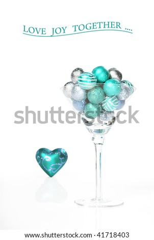 Chocolate balls in a martini glass with a heart against a white background with space for text