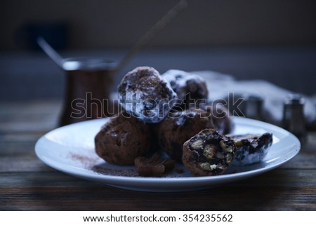 Chocolate balls on a plate on wooden background