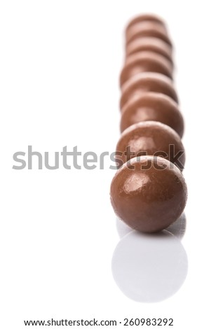 Chocolate balls with over white background - stock photo