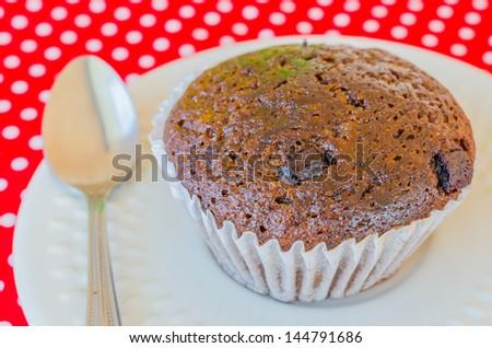 Chocolate banana cupcake on white dish - stock photo