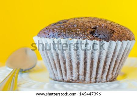 Chocolate banana cupcake with yellow background - stock photo