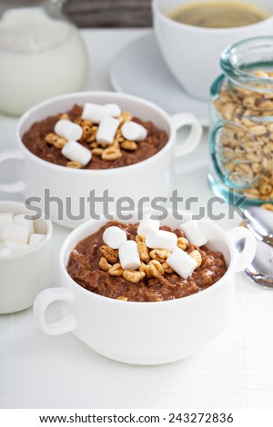 Chocolate banana oatmeal served for breakfast for two - stock photo