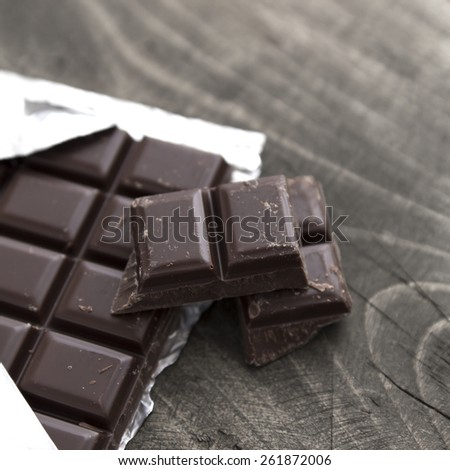 Chocolate Bar on wooden table, close up - stock photo