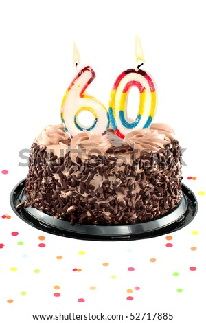 Chocolate birthday cake surrounded by confetti with lit candle for a sixtieth birthday or anniversary celebration - stock photo