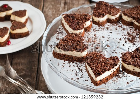 Chocolate Biscuit Valentine Cake in the Shape of Heart with White Custard - stock photo