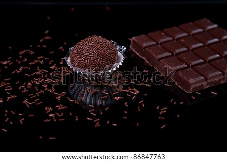 chocolate - brigadier, on black with reflexion - stock photo