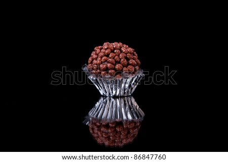 chocolate - brigadier  with nuggets, on black with reflexion