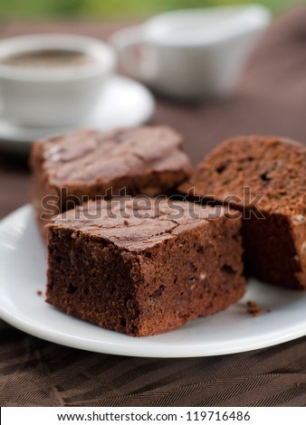 Chocolate brownie with coffee, selective focus - stock photo