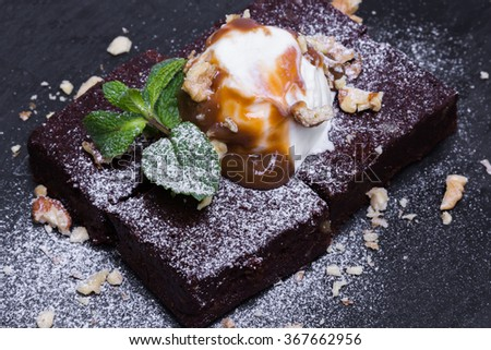 Chocolate brownie with ice cream on top, closeup - stock photo