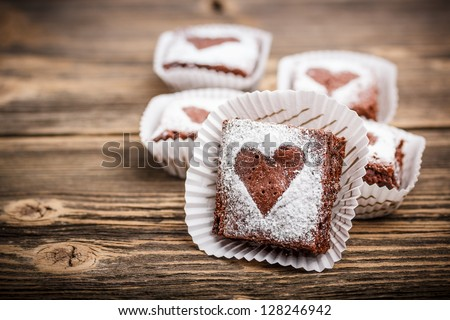 Chocolate brownies dessert on rustic wooden background - stock photo