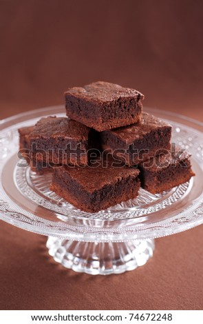Chocolate brownies on the cake stand - stock photo