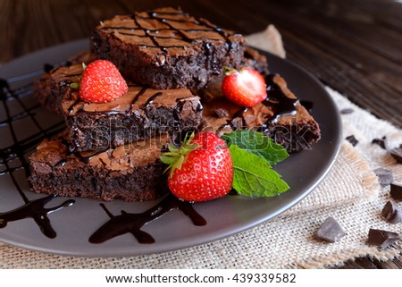 Chocolate brownies with strawberries