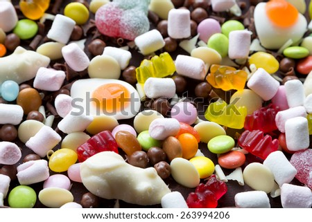 Chocolate cake decorated with loads of sweet candy - stock photo