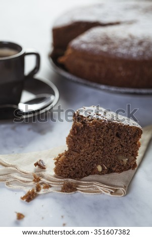 Chocolate cake in a marble table with coffee cup