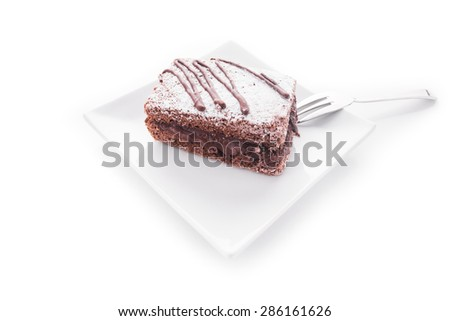Chocolate cake on plate isolated on white background