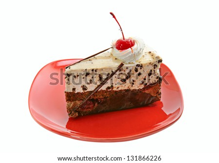 Chocolate cake on red dish with cherry, isolated - stock photo