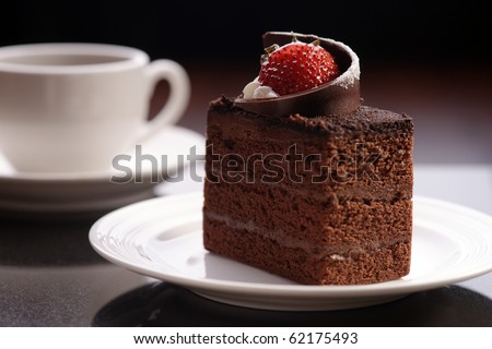 chocolate cake on the white plate with a cup of coffee - stock photo