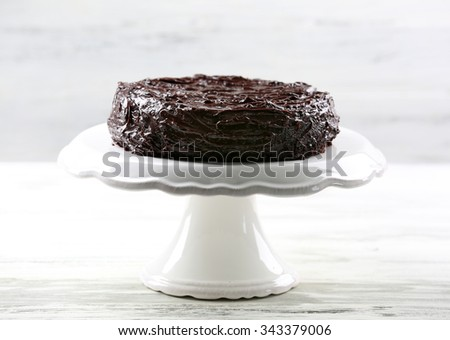 Chocolate cake on white wooden table - stock photo