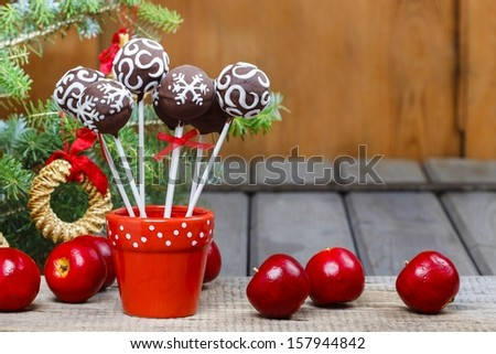 Chocolate cake pops in christmas setting - stock photo