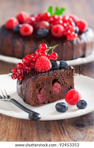 Chocolate cake slice with fresh berries, selective focus