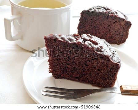 Chocolate Cake Slices at Breakfast. - stock photo