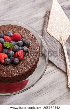 Chocolate cake topped with berries - stock photo