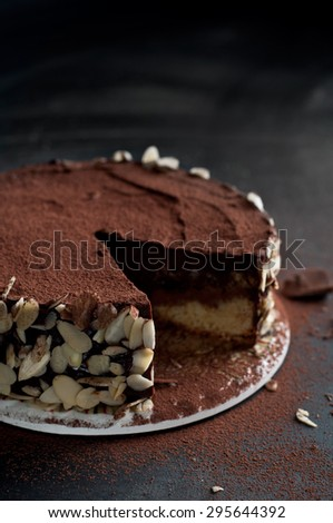 Chocolate cake. Vintage dessert tart with chocolate and almonds - stock photo