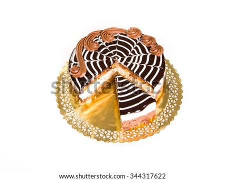 Chocolate cake with a slice cut out, top view - stock photo