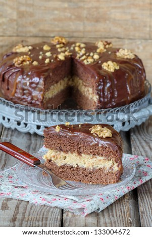 Chocolate cake with caramel and  walnut - stock photo