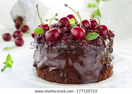 Chocolate cake with cherries and chocolate cream. - stock photo
